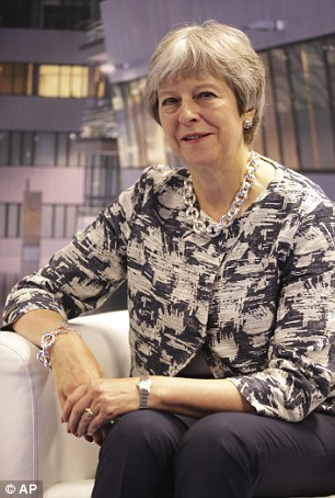 The PM (pictured in Brussels today) has been warned that her 'small cabal' in Downing Street must heed the views of the party rank-and-file or risk disaster