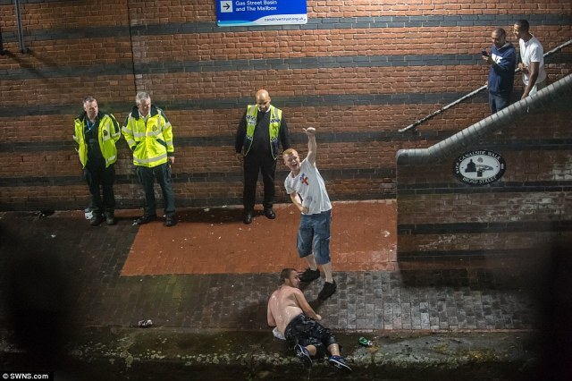 There werechaotic scenes as many jumped in the canals just off the bustling street, egged on by hundreds of onlookers in Birmingham
