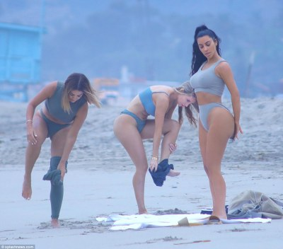 Kim Kardashian spotted doing yoga in a bikini on the beach