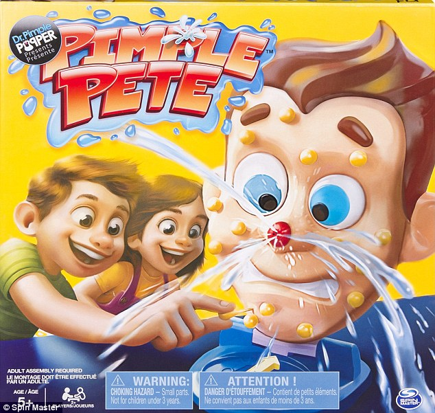 Bursts of fun: Dr Lee, 47, launched a new board game entitled Pimple Pete. The goal is for the player to extract as many fake zits as possible
