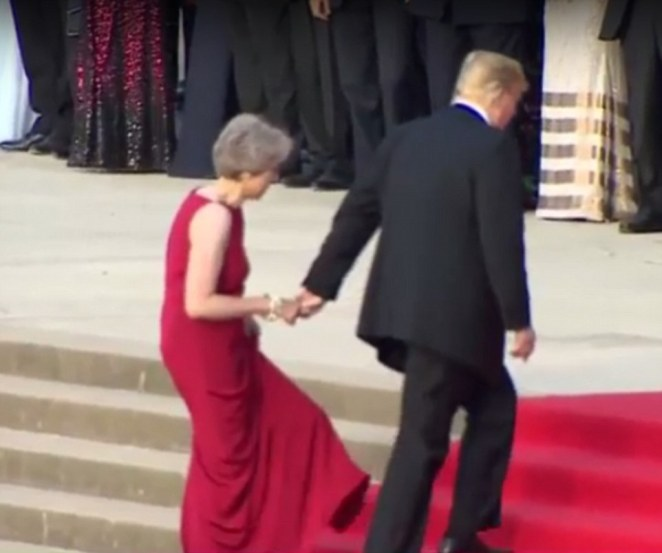 Awkwardly grabbing Theresa May hand - in a replay of their White House meeting last year - Trump was treated to a fanfare welcome by the Scots, Irish and Welsh Guards bands