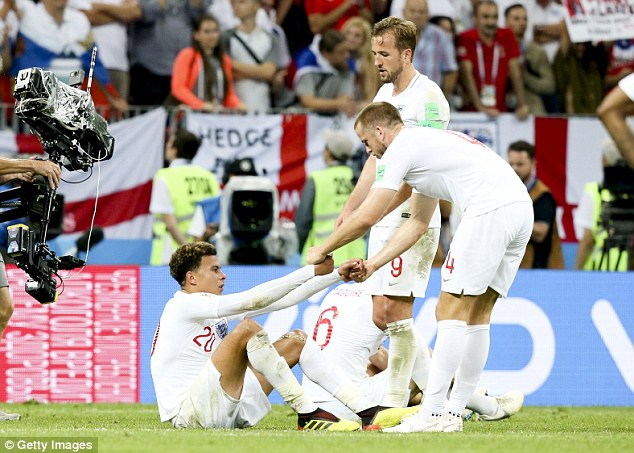 Alli was helped back to his feet by Tottenham team-mates Eric Dier and Harry Kane
