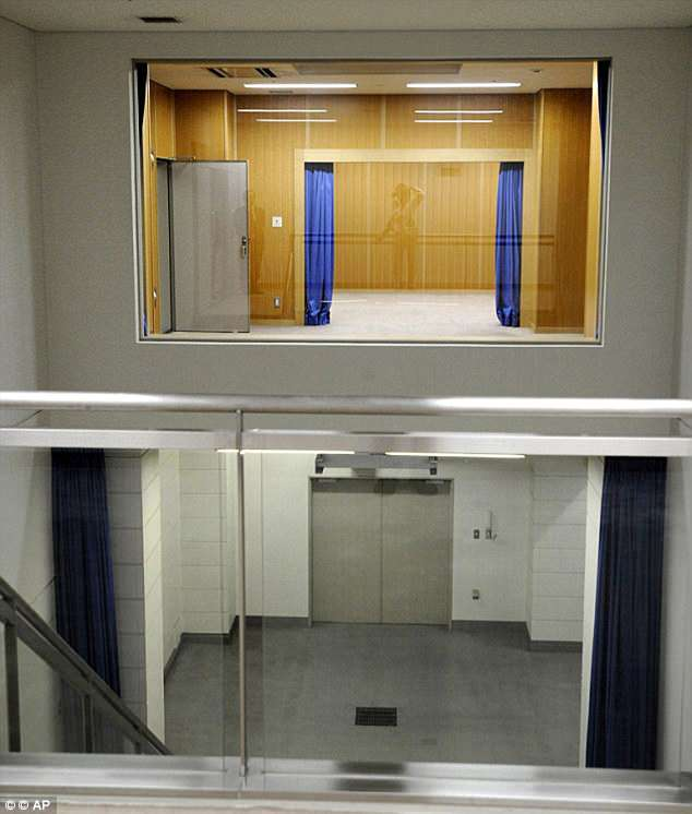 Death drop: The wood-paneled room above, with the blue curtains, is where the condemned prisoner is taken. A rope is tied around their neck and then they are dropped into the grey-tiled clinical room below