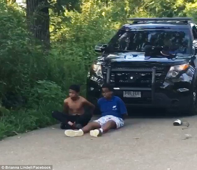 A cop pulled a gun against four young black teenagers then handcuffed them  in a Minneapolis Park on Monday after receiving a call saying they had a knife and a gun in their backpack