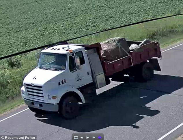 Police were able to identify him after finding security footage of the truck (pictured shortly after the boulder slid off)
