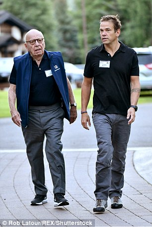 Family ties: Rupert and Lachlan Murdoch were seen heading to a session at the Allen & Co conference early Thursday morning (above)