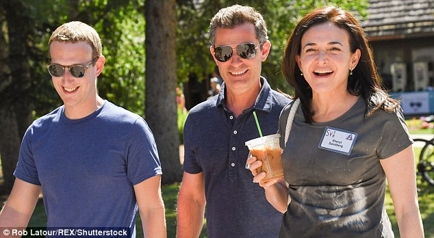 All smiles: Facebook's Mark Zuckerberg, Dan Rose and Sheryl Sandberg seemed to have forgotten about their besieged company's troubles as they attended the Sun Valley conference on Thursday