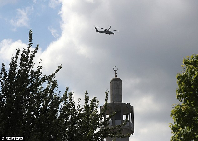Marine One comes in to land at the US Ambassador's central London residence this afternoon, which sits next door to theLondon Central Mosque in Regent's Park (minaret pictured)