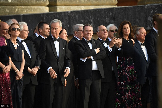 Dignitaries including International Trade minister Liam Fox (centre) awaited the President's arrival for the Blenheim dinner