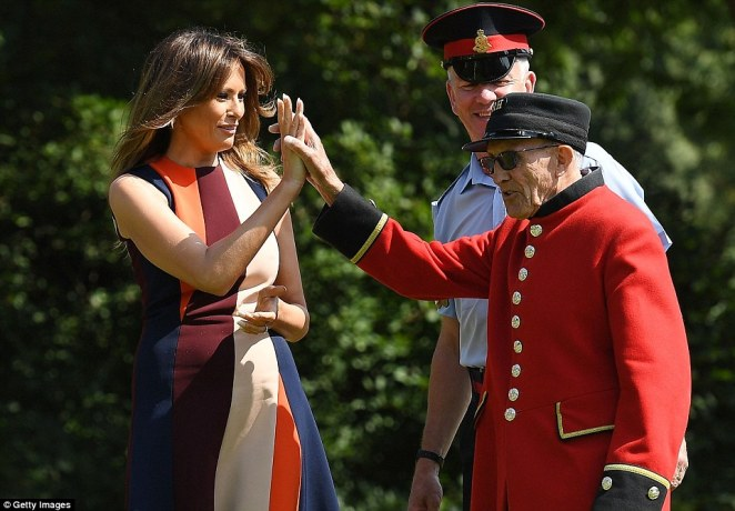Team spirit! Melania Trump high-fives a Chelsea Pensioner following the quick game of bowls at the hospital