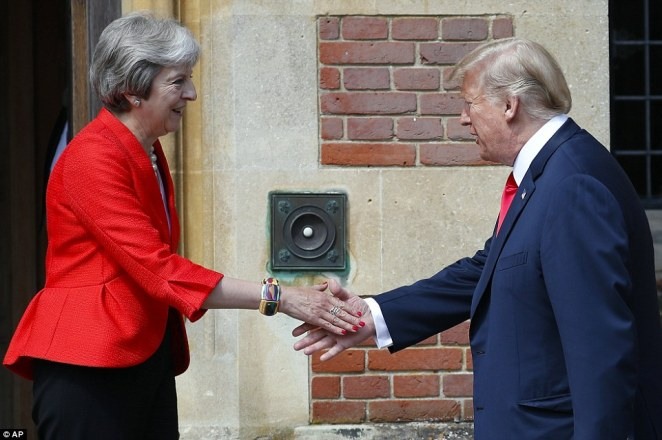 The two world leaders shook hands ahead of crunch talks as Mrs May had to swallow his criticism of her Brexit negotiations