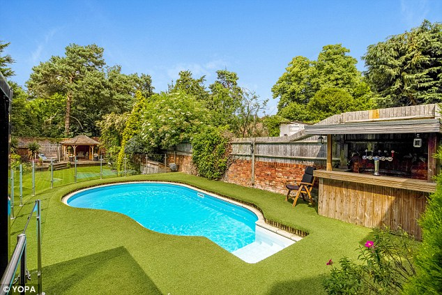 The Bromley property includes a swimming pool and an outdoor bar area
