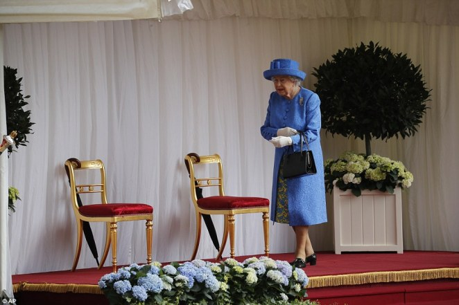 The Queen looked elegant in periwinkle blue as she awaited the arrival of President Trump and the First Lady on Friday