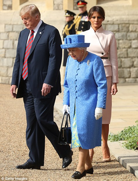 Keeping her distance: The Queen and President Trump appeared engaged in conversation as he prepared to inspect the Guard of Honour, however Melania remained a few paces behind, allowing them to chat in private