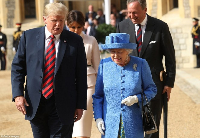 Donald Trump speaks with the Queen as First Lady Melania walks behind as they leave the Quadrangle following an inspection of the Coldstream Guards
