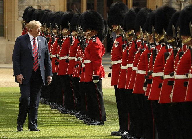 Donald Trump inspects the Guard at Windsor Castle, where he was treated to a rousing performance of his country's national anthem