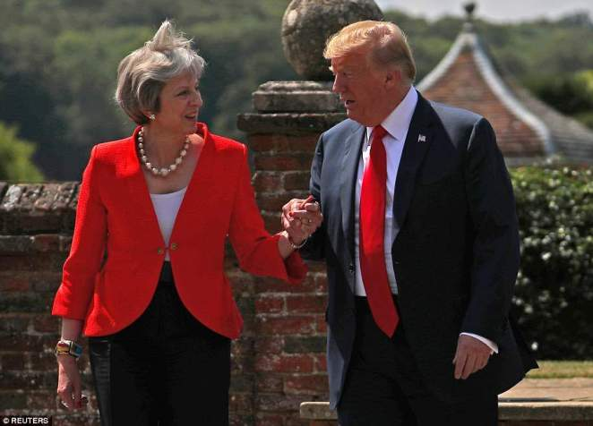 Figure 1: Donald Trump and Theresa May tried to put on a show of unity and friendship at the Chequers press conference by walking down hand in hand as they addressed the press
