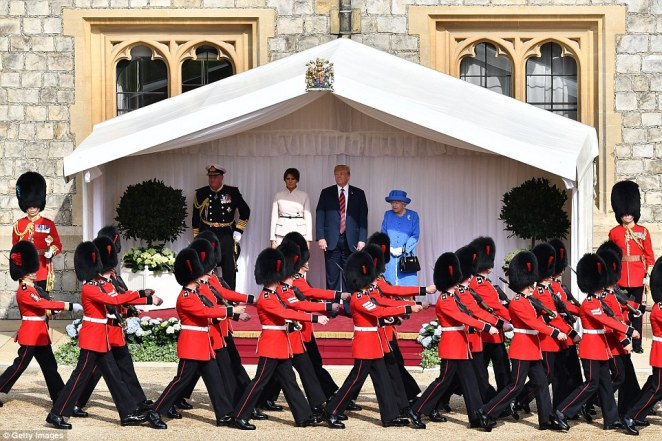 The Guard of Honour parades past President Donald Trump, First Lady Melania Trump and the Queen at Windsor Castle in Berkshire this afternoon