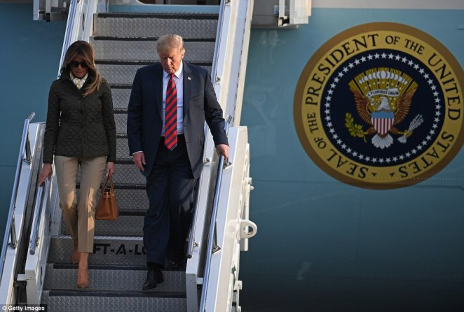 Glamour: Melania made sure to maintain some of her fashionable flair in the form of a chic silk neck scarf, large dark sunglasses, her trademark nude heels, and an Hermes Birkin bag