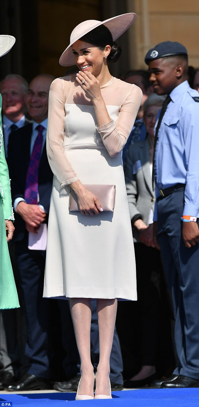 The Duchess of Sussex at a garden party at Buckingham Palace - her first royal engagement after being married