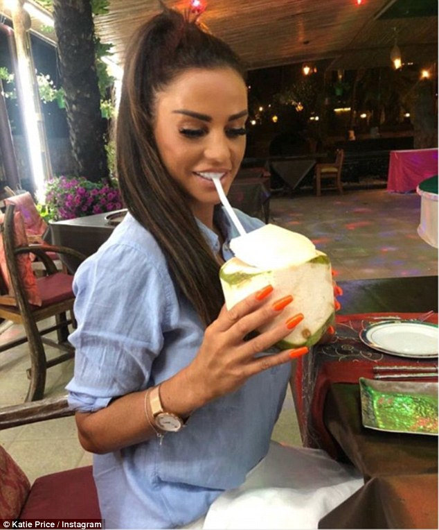 Refreshed: Katie Price enjoyed a relaxing coconut drink as she continued to soak up the sun in Asia, as it was reported she is tiring of her toyboy beau Kris Boyson's wild partying ways