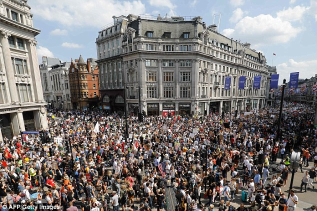 Huge turn-out: Around 100,000 people have flooded central London to demonstrate against Donald Trump's visit to the UK