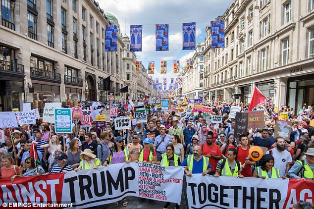 'Together against Trump!': Protesters at the front of the march led the way with a gigantic banner spanning the width of Regent's Street