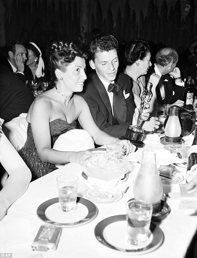 """Frank and Nancy Sinatra on March 11, 1946, at a crowded table at Ciro's, after Sinatra won an Oscar for his performance in the film """"The House I Live In"""""""