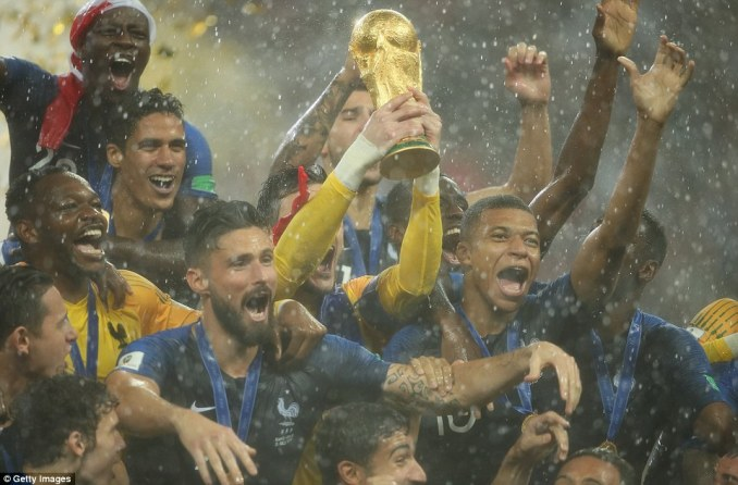 The players can barely be seen through the rain but the France players don't let it dampen their spirits as they celebrate