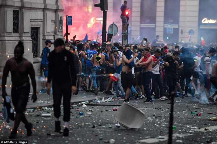 About 4,000 police watched over the fan zone - packed to its 90,000 capacity - during the match, then moved to the Champs-Elysees and neighboring streets