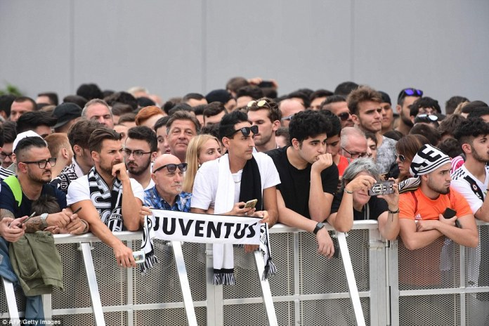 Juventus fans gathered outside the club's medical centre from early on Monday morning as they await the arrival of the club's new £100million signing Cristiano Ronaldo, who is due to complete his move from Real Madrid