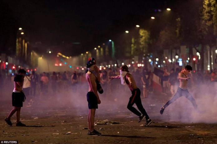 France fans clash on the Champs-Elysee following their nation's win in Moscow