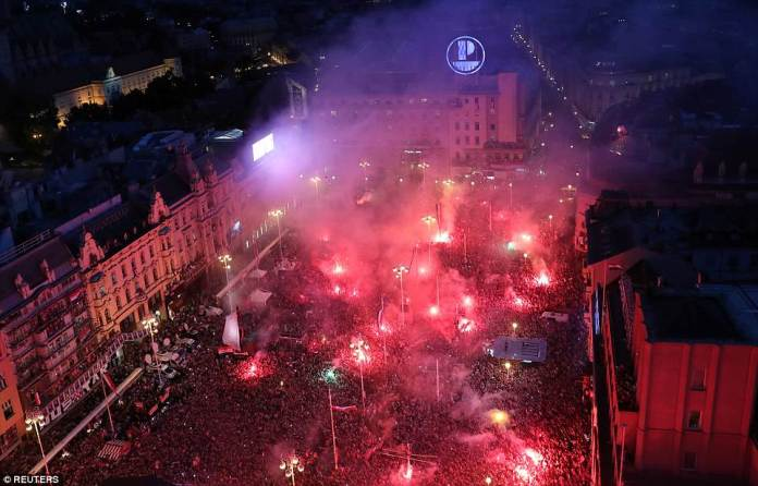Thousands of fans crowded intoBana Jelacica Square in Zagreb to catch a glimpse of their heroes this evening