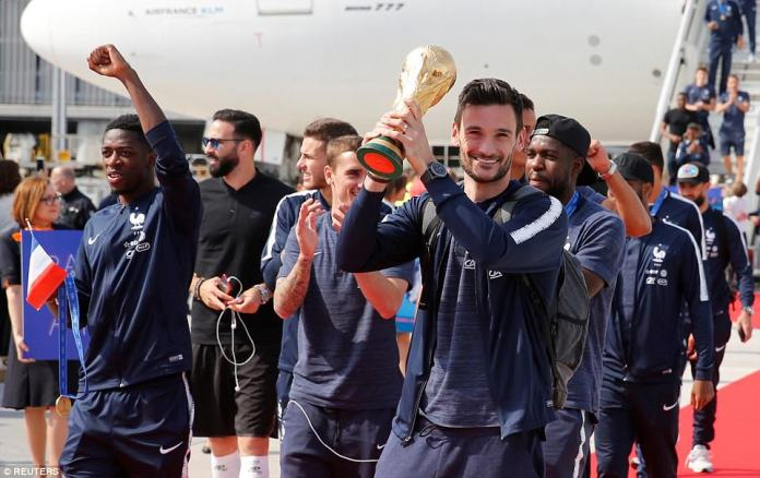The France team return from the World Cup in Russia, with captain and goalkeeper Hugo Lloris holding up the trophy handed out in Russia