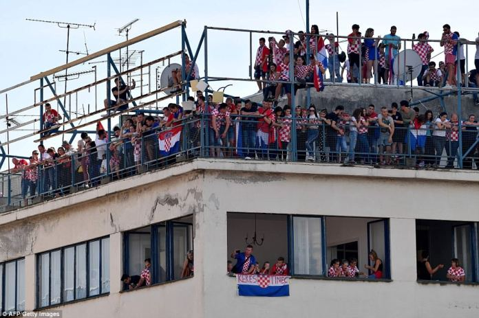 Supporters were seen on the roof of buildings and hanging flags from windows as they waited to see their heroes