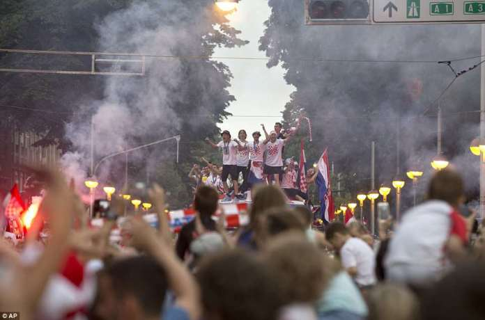 Crowds of fans looked delighted as they greeted the Croatian team as they stood on top of an open top bus