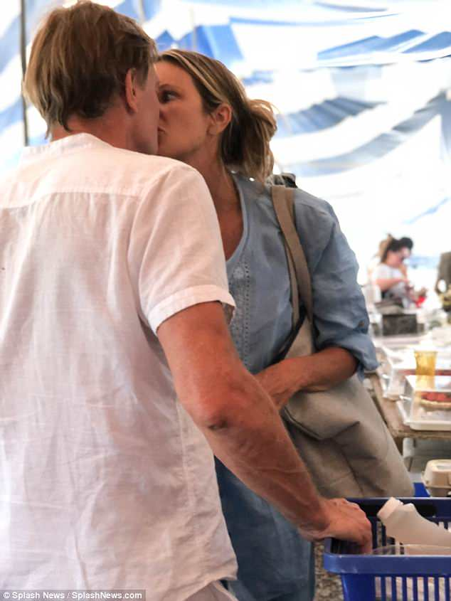 Moving on: Elle Macpherson, 54, locked lips with new man Andrew Wakefield while shopping at Glaser's Farm organic market in Miami on Friday