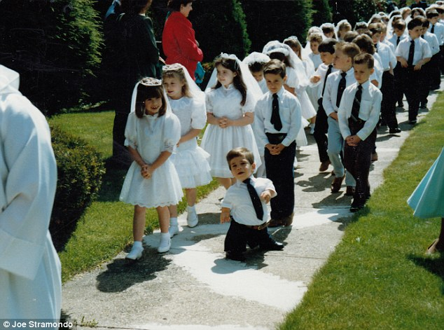 Joe, pictured at his First Holy Communion in his home state of Connecticut; he says in the film: 'I think there is this cultural understanding that, when you see people like me, the core of the experience is negative,' Joe says. 'And when people have low expectations, it's surprising to them when I indicate somehow that I'm not suffering'