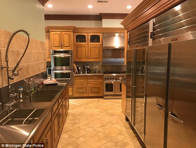 The home is outfitted with a commercial-style kitchen with high-end appliances