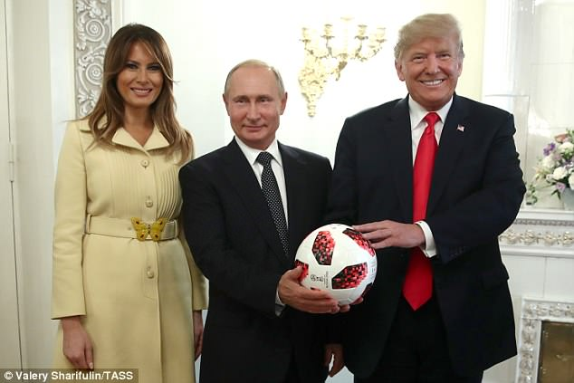 PALS: First lady Melania Trump poses with presidents Putin and Trump after a conference of press at the presidential palace in Finland