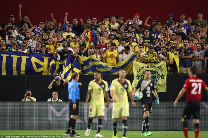 Club America fans spurs their team on during the first-half of action between the two teams in the blazing heat