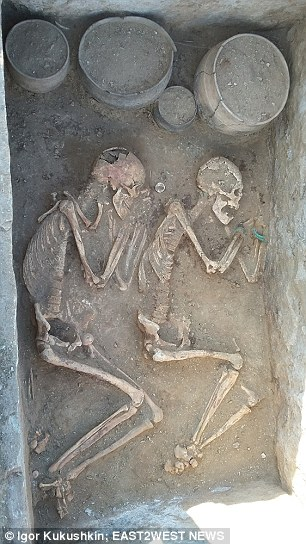 The prehistoric lovers, unearthed in the Karaganda region of Kazakhstan, lie on their sides close to each other, the man armed with a quiver of arrows and a metal dagger