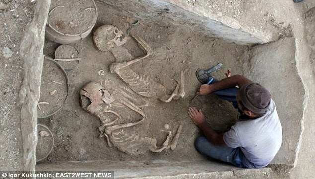 A 5,000-year-old grave has been found containing an ancient 'Romeo and Juliet couple' (pictured) buried close to the tomb of two horses pulling a Bronze Age 'chariot' into the afterlife