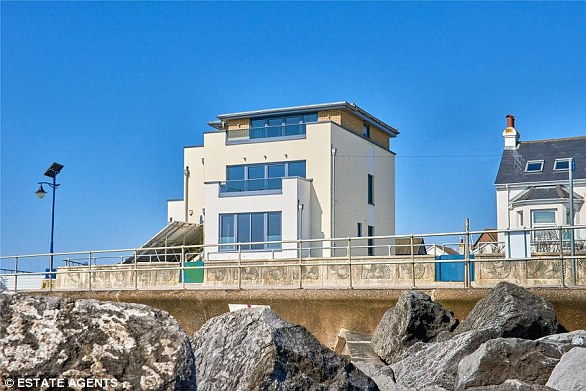WEST SUSSEX: Gull Point, near Bognor Regis, has four bedrooms and four balconies, including two in the master bedroom. The second-floor open living area has floor to ceiling doors.Struttandparker.com. £950,000