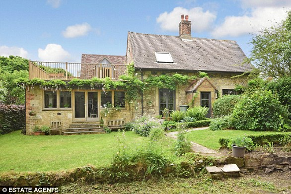 ISLE OF WIGHT: In Shanklin, this four-bedroom, detached stone cottage with a wood-burning stove in the hall, also has a large balcony overlooking the secluded rear garden and countryside.fineandcountry.com.£500,000