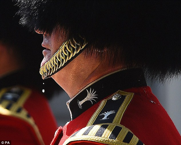 Britain is experiencing a blistering summer heatwave, with temperatures set to top 36°C (97°F) in parts of the UK today. Pictured is aQueen's Guard soldier in the heat in London last week