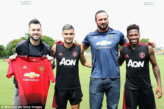 WWE announcer Mike Rome (right) and wrestler Drew McIntrye visited Manchester United