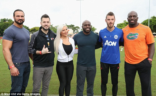 Apollo Crews and Dana Brooke (centre pairing) also turned up, along with Titus O'Neil (right)