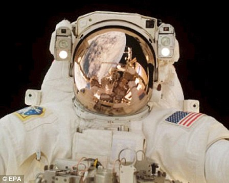 Scott Parazynski works outside the International Space Station during the third spacewalk of the STS-120 mission  30 October 2007.