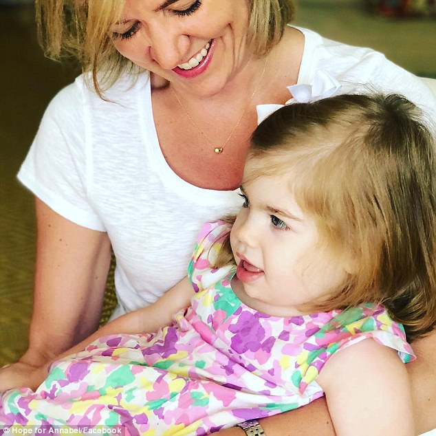 Over the course of 20 months they visited a number of specialists - seven different neurologists, a gastroenterologist, a geneticist, and a ear, nose and throat doctor - and ordered a battery of tests. Pictured: Annabel and her godmother